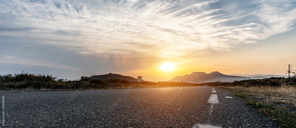 Fototapeta Mediterranean sea coast road into mountains horizon in summer with beautiful bright sun rays