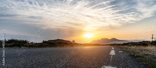 Fototapeta Mediterranean sea coast road into mountains horizon in summer with beautiful bright sun rays obraz
