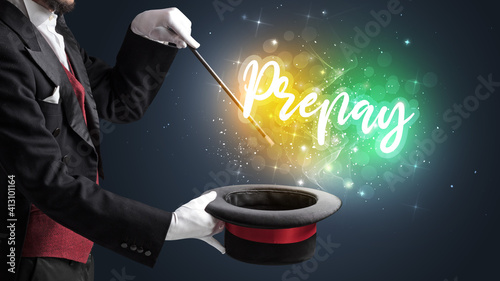 Fotografie, Tablou Magician hand conjure with wand and Prepay inscription, shopping concept