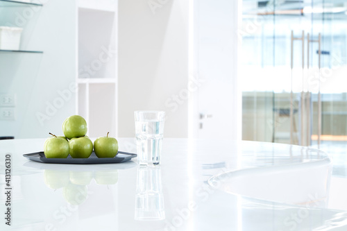 Close-up Of Granny Smith Apples On Table At Home Poster Mural XXL