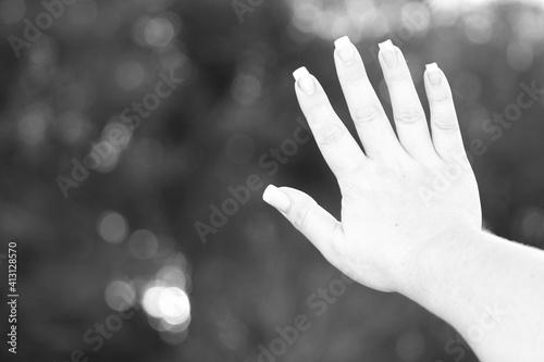 Fotografiet Close-up Of Woman Hand Showing Her Fingernails Outdoors