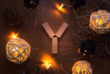 Directly Above Shot Of Letter Y Blocks And Illuminated Lights On Wooden Table
