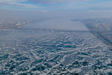 Frozen river from a drone. Beautiful ice on the water