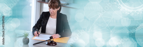 Photo Female lawyer working on document; panoramic banner