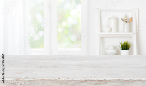 Obraz na plátně Bleached wooden table top on blurred kitchen summer window background