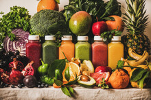 Various Fresh Smoothies For Detox Weight Loss Diet Program. Colorful Juices In Vacuum Bottles With Fruit, Vegetables And Greens Around, White Background. Vegan, Vegetarian, Clean Eating, Alkaline Food