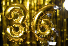 The Golden Number 36 Thirty Six Is Made From An Inflatable Balloon On A Yellow Background. One Of The Complete Set Of Numbers. Birthday, Anniversary, Date Concept