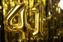 The Golden Number 41 Forty One Is Made Of An Inflatable Balloon On A Yellow Background. One Of The Complete Set Of Numbers. Birthday, Anniversary, Date Concept