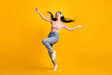 Full Size Photo Of Young Happy Crazy Smiling Cheerful Girl Dancing In Headphones With Flying Hair Isolated On Yellow Color Background