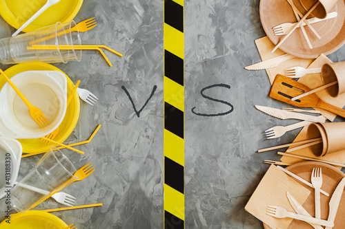 Fototapeta Top above  view photo of white and yellow plastic and wooden  utensils compared on grey background. obraz
