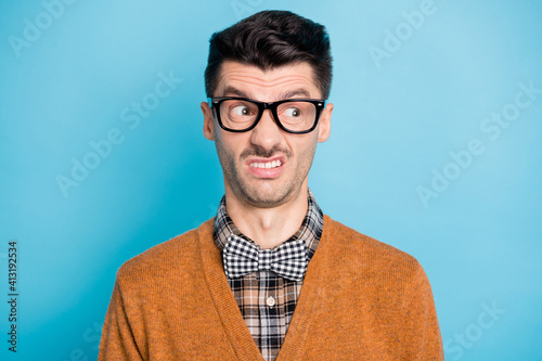 Fototapeta Photo of disgusted funky young guy look empty space dislike news isolated on pastel blue color background obraz