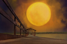 Wooden Pier On The Lake. A Silhouette Of A Man In The Distance. A Huge Sun Among The Clouds Above. A Combination Of Photography And Illustration.