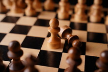 Close-up Of Chess On A Black Background. Wooden Chess Pieces. Concept: The Board Game And The Intellectual Activities