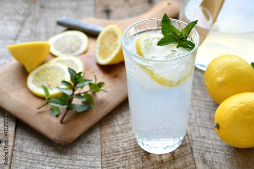 Fototapeta Fruit And Drink In Glass On Table obraz