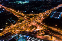 Car Traffic Transport On Multiple Lane Highway Or Winding Road Expressway In Asia City At Night, Drone Aerial View, High Angle. Civil Engineering Technology, Asian Transportation Concept