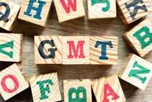 Alphabet Letter Block In Word GMT (abbreviation Of Greenwich Mean Time) With Another On Wood Background