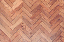 Parquet Wooden Old Scratched Floor With Herringbone Pattern