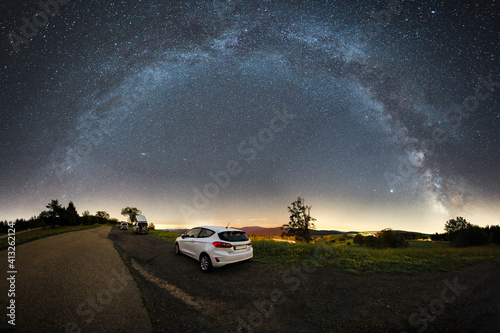Obraz car in front of the milky way panorama shot on the schauinsland near freiburg - fototapety do salonu