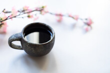 Singing Bowl Or Tibetan Bowl On White Table With Cherry Flower.