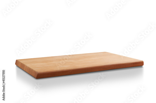 Obraz new rectangular wooden cutting board, in top of wooden table with a minimalistic limbo background - fototapety do salonu