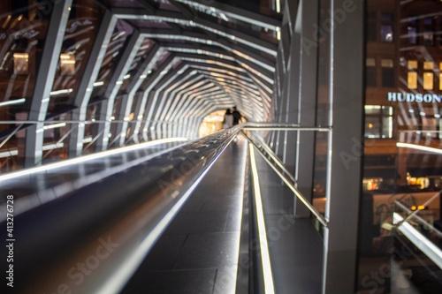 Photo Rear View Of People On Footbridge At Night