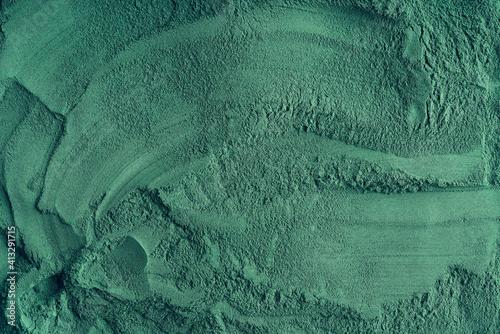 Fotografia Green background made of spirulina algae powder