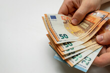 Man's Hands Hold Euro Banknotes