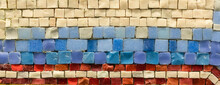 Elements Of A Mosaic Of Yellow, Red, Red, Blue And Purple Stone. Horizontal Direction Of Rows,