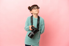 Little Photographer Girl Isolated On Pink Background And Looking Up