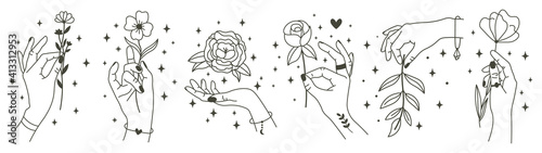 Obraz Magical hands holding flowers. Minimalist hands and flowers, abstract hand drawn floral symbols. Modern magical tattoo elements vector illustration set. Magic flower, mystic hand beauty with bloom - fototapety do salonu