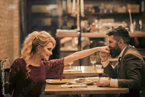 Obraz na plátně Beautiful couple in love dating and drinking at restaurant