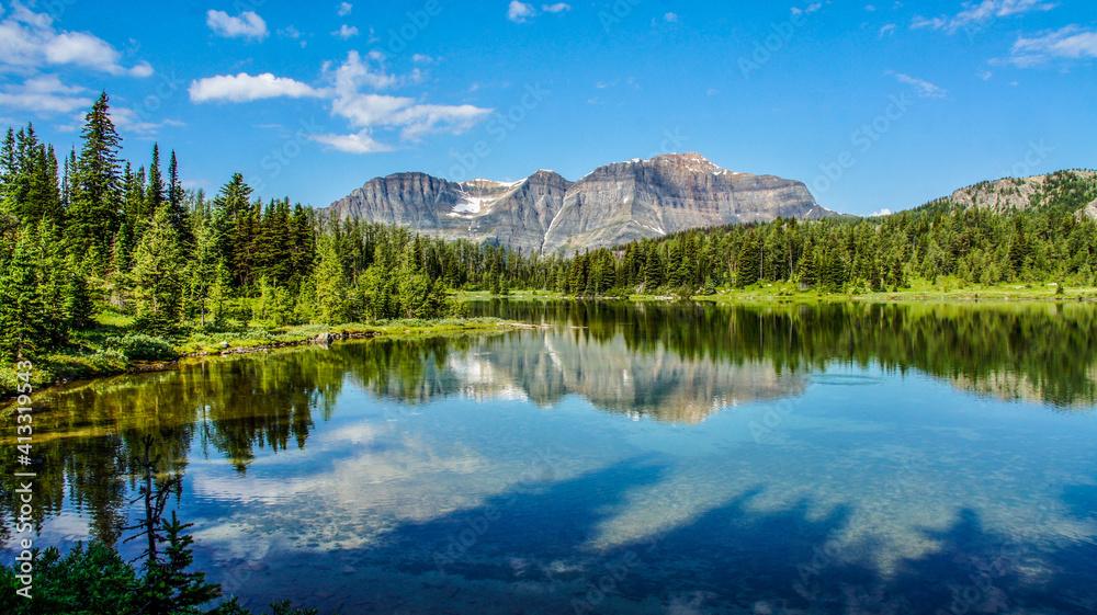 Fototapeta Scenic View Of Lake By Trees Against Blue Sky