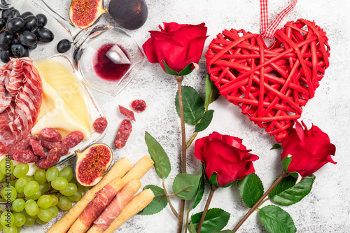 Canvas-taulu Valentines Day background with appetizers on table italian antipasto snacks and wine