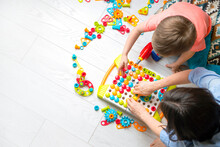 Montessori Method. Little Boy Playing With Mother In Educational Game Constructor.