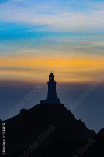 Low Angle View Of Lighthouse Against Sky During Sunset Wallpaper Mural