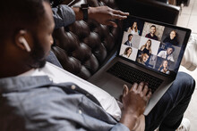 Side View. Young African American Business Man Making Video Call Looking At Laptop Screen, Confident Positive Young Coach Teaching Remote Lesson, Businessman Participating In Online Conference.