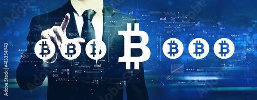Fototapeta Bitcoin theme with businessman on a dark blue background obraz