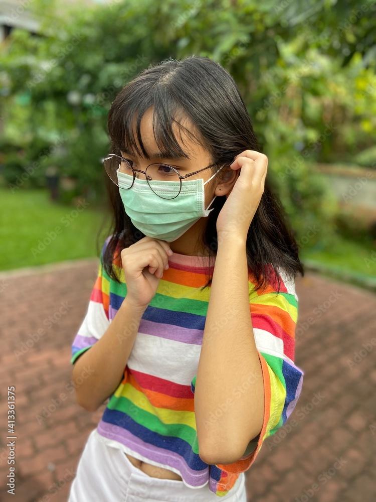 Fototapeta Portrait Of A Girl Wearing Mask