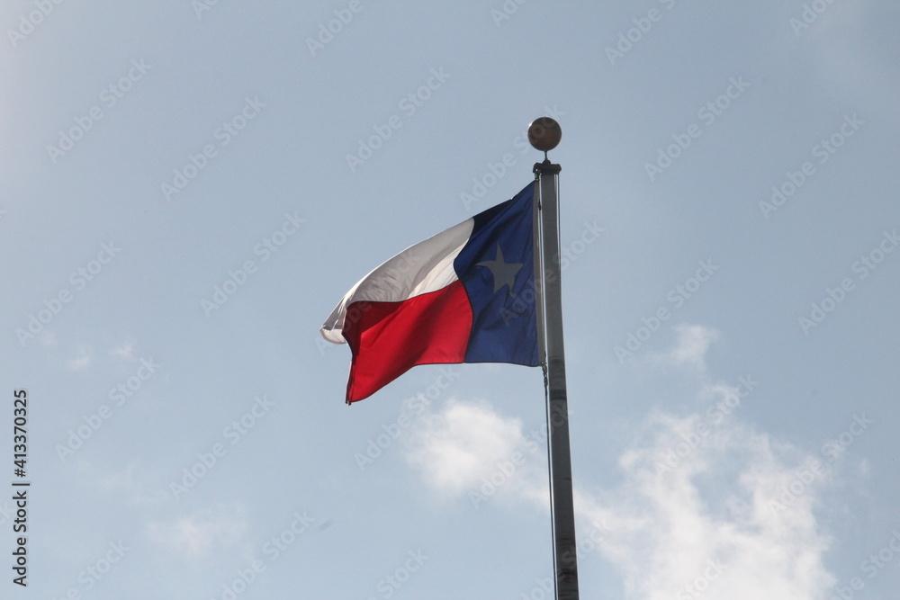 Fototapeta Low Angle View Of Flag Waving Against Sky