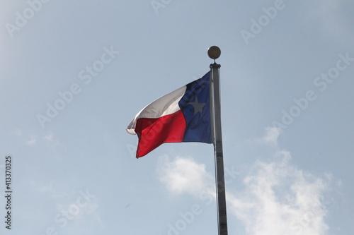 Fototapeta Low Angle View Of Flag Waving Against Sky obraz