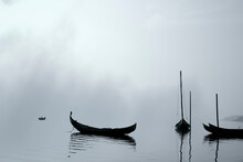 Traditional Fisherman Wooden Boats In The Fog
