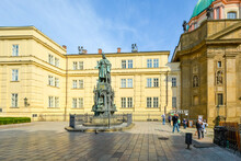Tourists Enter The Charles Bridge Museum Near The Statue Of Charles IV In The Knights Of The Cross Square Near The Old Tower In Prague, Czechia