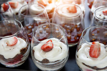 A Lot Of Glasses With Strawberry Dessert.