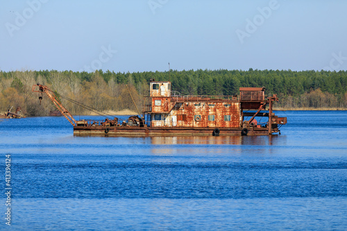 Tela Ukraine, Pripyat, Chernobyl. Rusted remains of barge in lake.