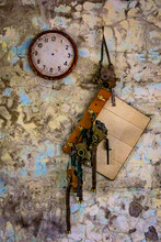 Ukraine, Pripyat, Chernobyl. A Clock With No Hands And Gas Masks Hanging From Hooks.