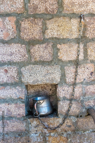 Water kettle at water fetching place, Lahij village on the southern slopes of Gr Fototapet