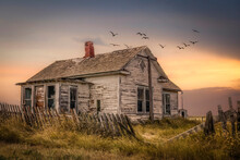 Old Farm House In Disrepair With A Broken Fence In The Fall