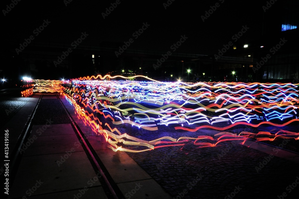 Fototapeta Light Trails On Street Against Sky At Night