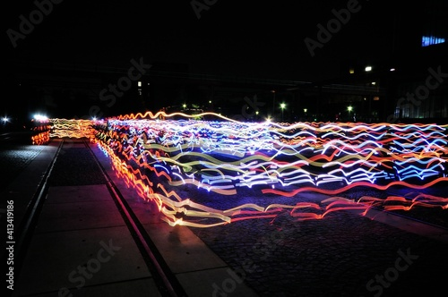 Fototapeta Light Trails On Street Against Sky At Night obraz