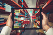 canvas print picture - Smart warehouse management system using augmented reality technology to identify package picking and delivery . Future concept of supply chain and logistic business .